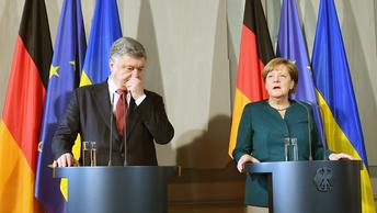 Порошенко и Меркель посекретничали о России и миротворцах в Донбассе
