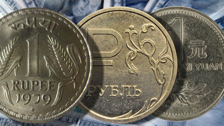 Как рубль, юань и рупия укажут доллару на его новое место