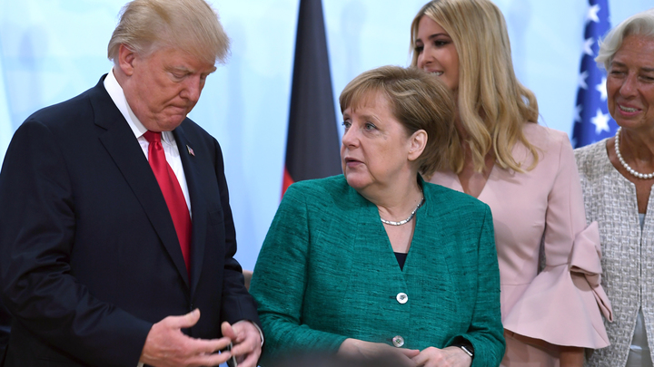 Немецкая Deutsche Welle высмеяла Трампа и Меркель, показав их слугами Путина