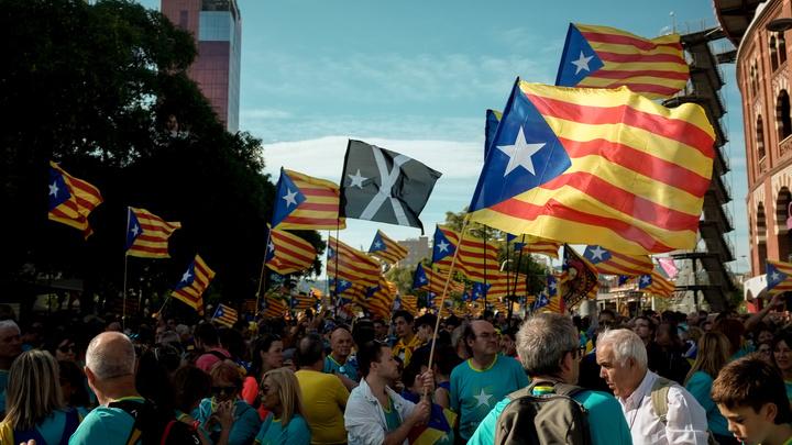 Лидеров движения за отделение Каталонии наказали реальными сроками
