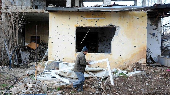 Африн оцеплен: Курды обвиняют Турцию в обстреле дороги эвакуации