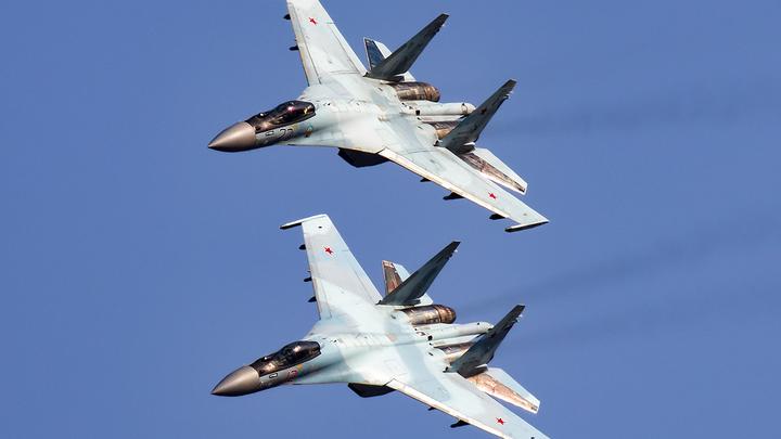 Вежливо указал на выход. Российский Су-27 отвадил американского шпиона от границы