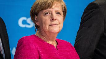 Меркель не скрывала радости при голосовании на выборах в бундестаг