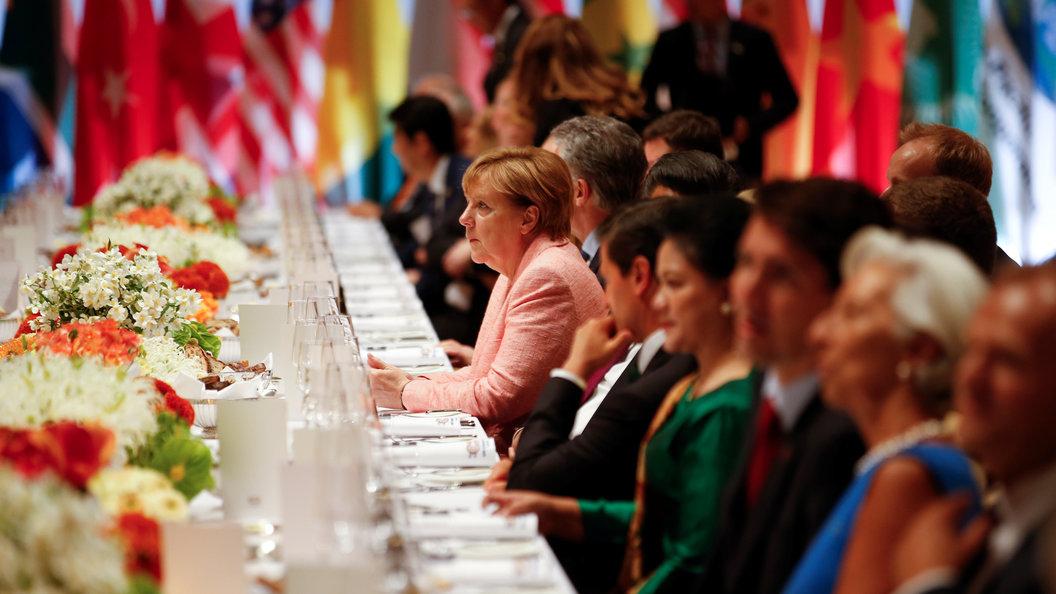 В Гамбурге начался рабочий завтрак Путина, Меркель и Макрона