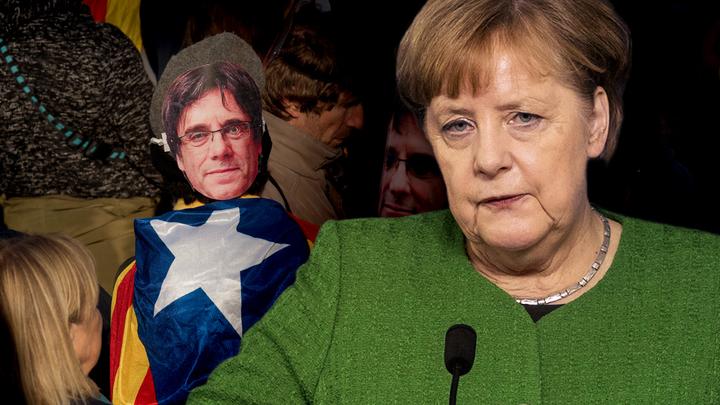 Меркель затягивает с выдачей Испании лидера Каталонии