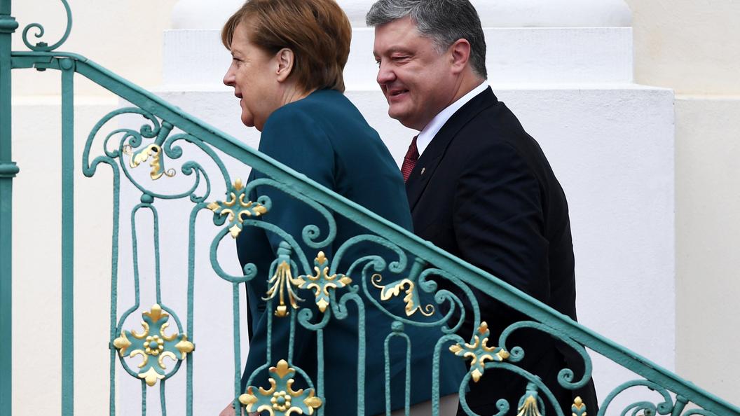 Одни разговоры: Порошенко обсудил с Меркель обмен пленными в Донбассе