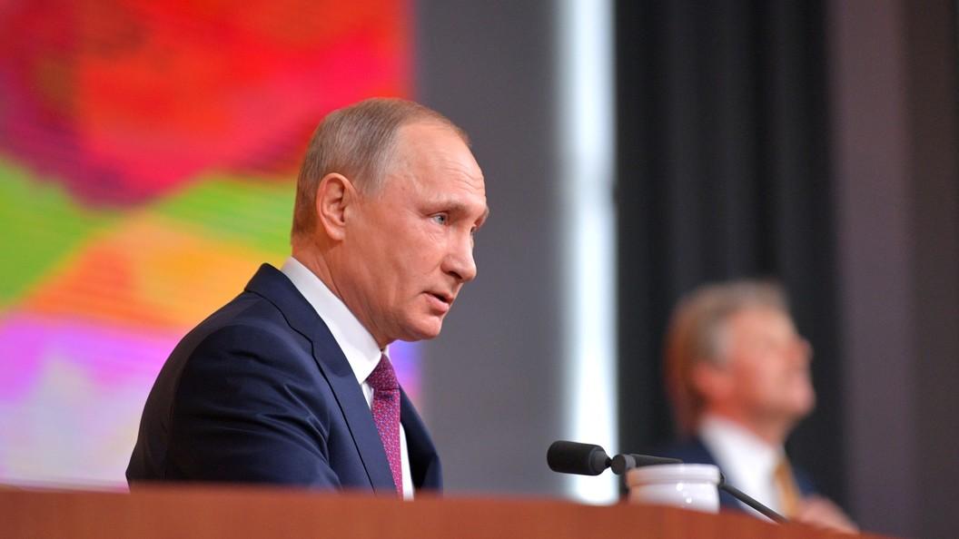 Бирюков: Есть кандидат Путин и есть против Путина, за ликом которого виднеется знак доллара