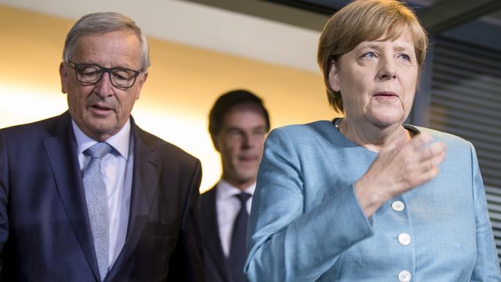 Видео: Глава Еврокомиссии прилюдно сбросил звонок от Меркель