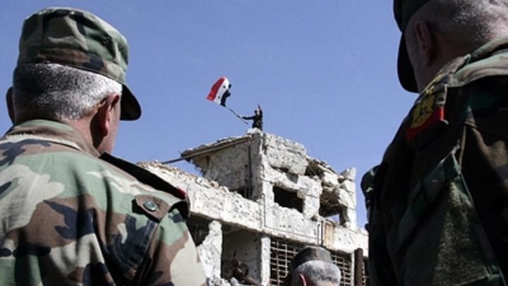 Восвобождённом оттеррористов городе Босра-эш-Шам подняли флаг Сирии
