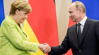 Меркель в Сочи: С Путиным против Трампа