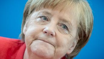 Меркель под давлением согласилась изменить миграционную политику
