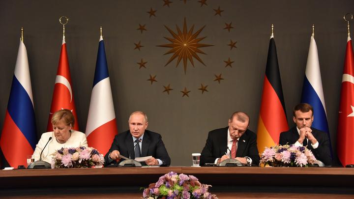 «Сибирское пальто» Путина заставило Меркель заговорить по-русски - видео