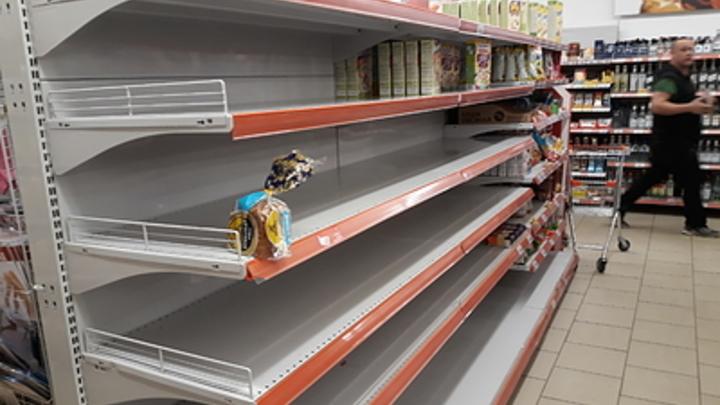 Ретейлеры припугнули чиновников пустыми полками в магазинах