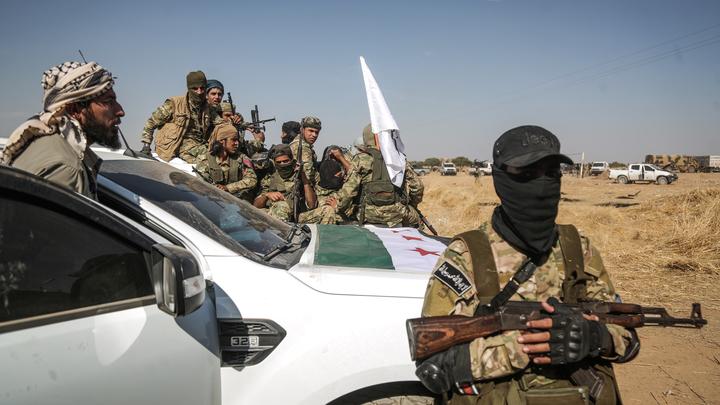Турецкий МИД свалил вину за истребление курдов в Сирии на США