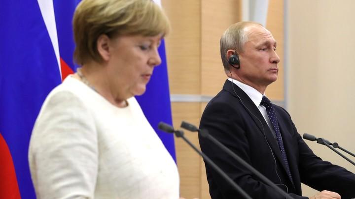 Меркель не намерена отказываться от встречи с Путиным после твита Трампа