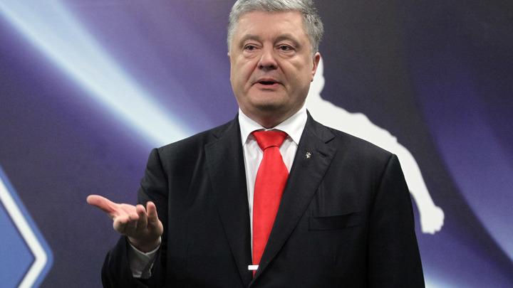 Порошенко попросил Меркель наказать Россию новыми санкциями за выдачу паспортов Донбассу