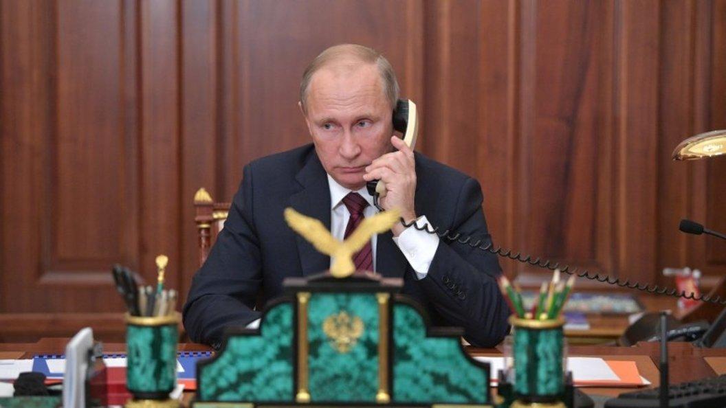 Путин побеседовал  сМеркель