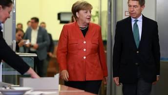 Экзит-поллы Германии: партия Меркель набрала треть голосов избирателей
