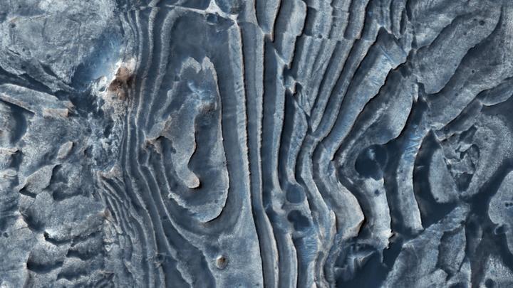 Царство сухого льда: NASA показало, как выглядит зима на Марсе