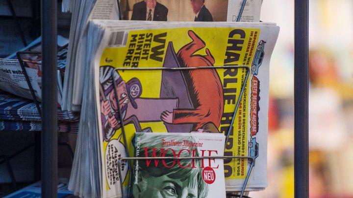 Кукла Собчак и связанный Навальный: Charlie Hebdo выпустил издевательскую карикатуру про выборы в России